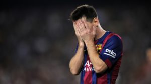 FC Barcelona's Lionel Messi, from Argentina, holds his hands to his face during a Spanish La Liga soccer match at the Camp Nou stadium against Eibar in Barcelona, Spain, Saturday, Oct. 18, 2014. (AP Photo/Manu Fernandez)