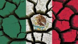 Mexico flag painted on cracked earth background.