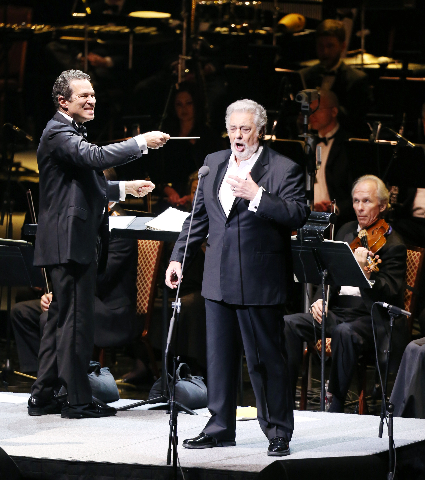 Guest Conductor Maestro Eugene Kohn, left, and legendary opera singer, Placido Domingo, perform with members of the Las Vegas Philharmonic at the Colosseum at Caesars Palace hotel-casino Tuesday, Sept. 15, 2015, in celebration of Mexican Independence Day. (Bizuayehu Tesfaye/Las Vegas News Bureau)